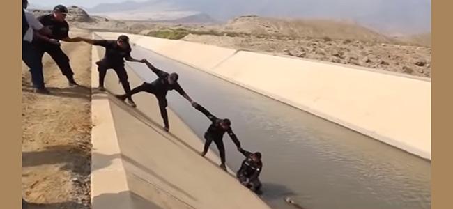 Αστυνομικοί έκαναν αλυσίδα για να σώσουνε ένα κουτάβι! (Βίντεο)